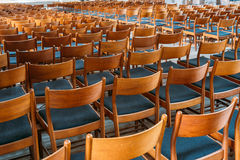 Many Empty Wooden Chairs With Backrest, Blue Upholstery Standing. Many Empty The Same Wooden Chairs With Backrest And Blue Upholstery Standing In Neat Rows In Stock Images