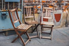 Many empty wooden chairs Stock Image