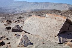 Many engraved on stones Toro Muerto, Peru Royalty Free Stock Image
