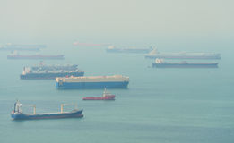 Many Enormous Cargo Ships Anchored in a Harbor Royalty Free Stock Images