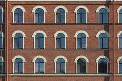 Many equal windows of the factory Royalty Free Stock Photography