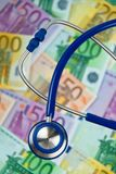Many Euro bank notes with a stethoscope. Stock Image
