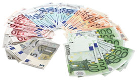 Many Euro banknotes. A bundle of Euro banknotes isolated on a white background Stock Photo