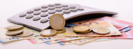 Many Euro banknotes and calculator Royalty Free Stock Photography