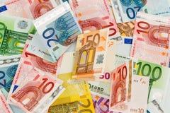 Many euro banknotes Stock Photo