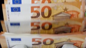 Many euro bills checked in a working money counter. 4K stock video footage