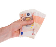 Many 50 euro bills in a hand. Isolated on white Stock Photography