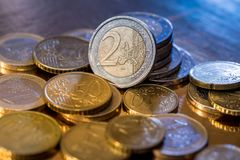 Many euro coin isolated on gold. Close up Royalty Free Stock Photo