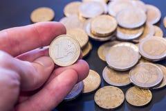 Many euro coins. On black background stock photo