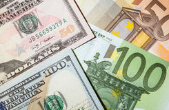 Many euro and dollar banknotes Stock Images