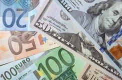 Many euro and dollar banknotes Stock Photography