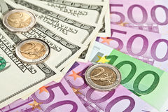 Many euro and dollar banknotes and coins Stock Image