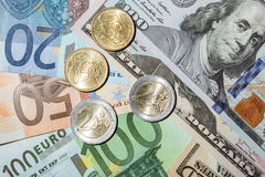 Many euro and dollar banknotes and coins Royalty Free Stock Photos
