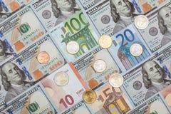 Many euro and dollar banknotes and euro coins Royalty Free Stock Photo