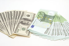 Many Euro and Dollars on white background Stock Images