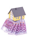 Many euro notes and a house- Stock Photography