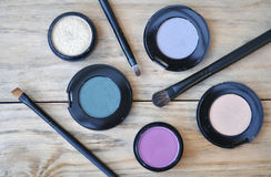 Many Eye Shadows And Brushes On Wood Table Stock Photos