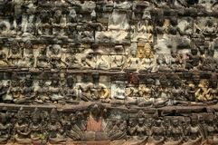 Many faces. Faced wall of the grand parade of the royal palace angkor cambodia Stock Photography