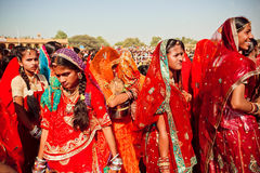 Many faces of indian women in the colorful crowd Royalty Free Stock Photography