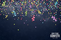 Many falling multicolored confetti and ribbons on a dark blue background. Celebratory background on birthday. New Year and snowfla Royalty Free Stock Images
