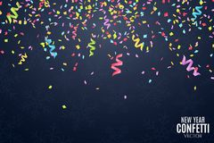 Many falling multicolored confetti and ribbons on a dark blue background. Celebratory background on birthday. New Year and snowfla Royalty Free Stock Photo