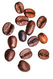 Many falling roasted coffee beans Royalty Free Stock Photography
