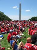 Many Fans and Washington Monument at the Rally on the Mall. Photo of enthusiastic washington capitals fans watching a jumbotron at a rally at the national mall stock photos