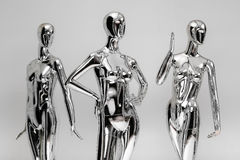 Many fashion shiny female mannequins for clothes. Metallic manne Stock Photo