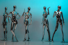 Many fashion shiny female mannequins for clothes. Metallic manne Royalty Free Stock Photos