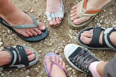 Many feet place on the ground. Stock Photos