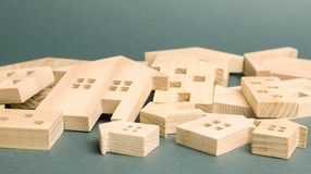 Many felled wooden houses. Destruction of houses as a result of natural disaster. The flood. Hurricane. Fire. Danger. Emergency. Housing. Reconstruction of old stock image