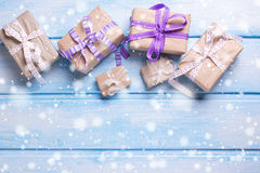Many  festive gift boxes with presents on blue wooden background Stock Photography