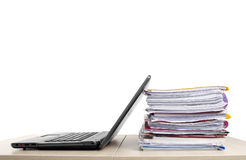 Many files and a computer on a desk Royalty Free Stock Photo
