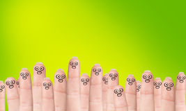 Many fingers with drawn faces Stock Images