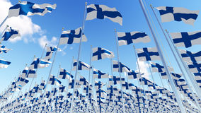 Many Finland flags on flagpoles against blue sky. Three dimensional rendering illustration. 3D illustration Stock Photo