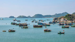 Many fishing boats are anchored in Halong Bay Stock Photos