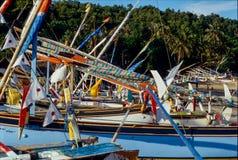 Colourful fishing boats in Padangbai, Bali, Indonesia stock images