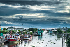 Many fishing boats docked. In the canal Stock Image