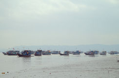 Many fishing boats in suburb of Mumbai Stock Photo