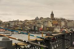 Many fishing rods are fixed on the Galata bridge of the Turkish. City of Istanbul, there are no fishermen nearby Stock Images