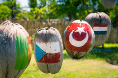 Many flags of countries painted on the coconuts. Many flags of countries painted on the hanging coconuts, Czech Republic Turkey Netherlands Stock Photos