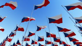Many flags of Czech Republic in front of blue sky. Royalty Free Stock Image