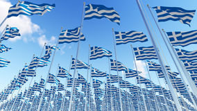 Many Flags of Greece on flagpoles against blue sky. Three dimensional rendering illustration. 3D illustration Royalty Free Stock Photography