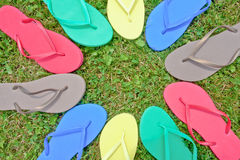 Many flip-flops Stock Images