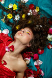 Many flowers in her hair Stock Photography