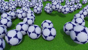 Many football balls rolling and bouncing on green grass field. 4K ProRes clip stock footage