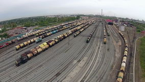 Many freight trains on railway tracks stock footage