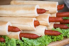 Many French Hot Dogs on lettuce. Delicious food. royalty free stock images