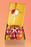 Many fresh apples in give box. Many fresh apples in luxury give box Royalty Free Stock Photo