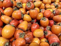 Many fresh fruits persimmons in supermarket, food concept. Many fresh fruits persimmons in supermarket, food background royalty free stock photos